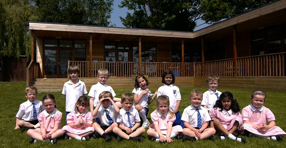 new school intake sitting outside their eco-classroom