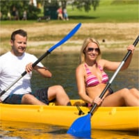 photodune-4396082-couple-sitting-in-kayak-on-a-sunny-day-xs.jpg