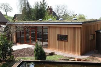 Eco Library with Sedum Roof at Dodford School by The Learning Escape