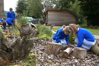 Children Bug Hunting Near their Outdoor Learning Shelter by The Learning Escape