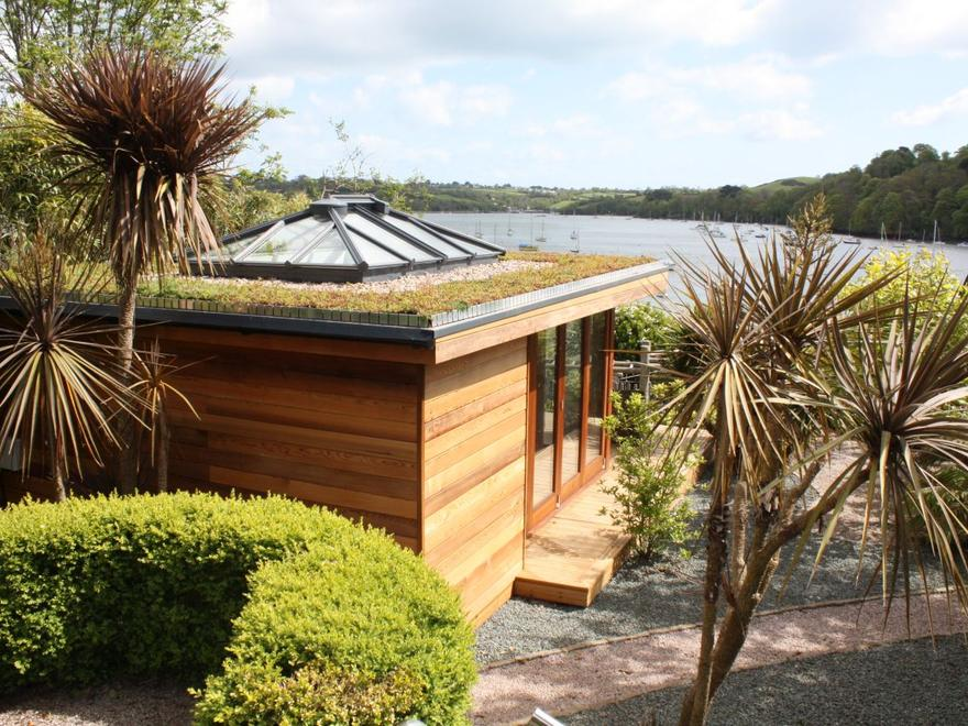 6m x 5m Garden Studio in Devon for around £39000. Built in March 2012 this Cube style building includes two sets of sliding folding doors, a large roof lantern and a living roof